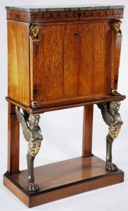 This diminutive French Empire abattant, mahogany with marble top over inlaid frieze, sold for $9,200.