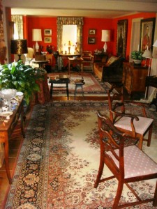 The living room of the main house, belonging to Thomas McBride, is filled with fine antiques.