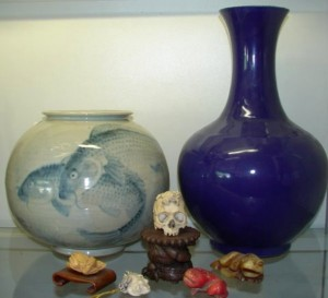Items from Asia, including porcelains, 19th century Roulade vase, blue with carp, and 15-inch Chiang Long altar vase, will be sold with no reserve.