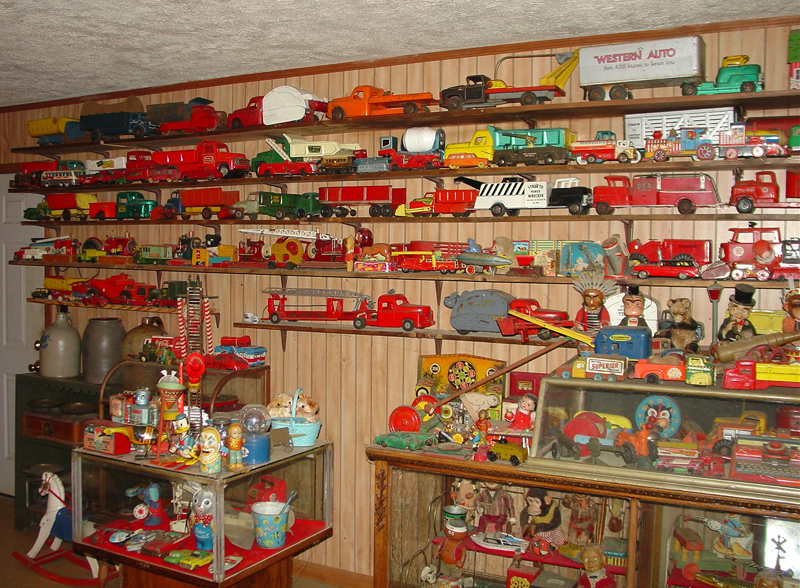 The hundreds of toys collected by Carl Gillespie, including antique steam engines, trucks and cars by various makers, vintage lunch boxes, figurines, Disney merchandise, porcelain pieces, highly decorated spinning tops and Coca-Cola signage and merchandise, will be sold at auction on June 12, 2010, in a sale hosted by Stevens Auction Company.