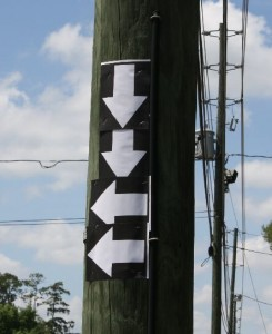 These are two postings of arrows for Carson & Barnes Circus at a recent (May 2010) appearance in Florida. The first group of arrows indicates the trucks are approaching the circus lot.