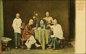 Unusual views: This pre-1908 postcard shows bookkeepers in Hong Kong, wearing traditional dress and using the abacus. In excellent condition, this postcard would be worth $15-$20.