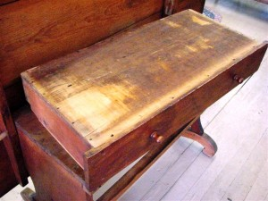 An examination of the bottom of this mid-19th-century drawer shows a lot of wear and stress on the bottom panel. That means there is a problem with the drawer slides either on the drawer itself or in the case.