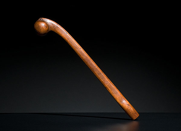 A Great Lakes ballhead club, late 19th century, of diminutive size; with burl head and elegantly flattened handle. It can be viewed as a piece of art or as a deadly weapon.