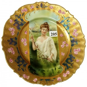 R.S. Prussia 8 ¾-inch mold #343 keyhole plate with spring season portrait décor.