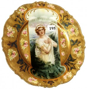R.S. Prussia 8 ¾-inch mold #343 keyhole plate with winter season portrait décor.