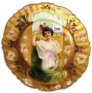 R.S. Prussia 8 ¾-inch mold #343 keyhole plate with summer season portrait décor.