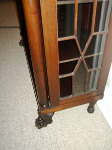 This Empire chain cabinet is missing two of the original panes of glass.