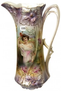 This 13 ¼-inch R.S. Prussia carnation mold tall tankard, white and lavender satin finish, is among the items up for bid in a sale hosted by Woody Auction on July 24, 2010.