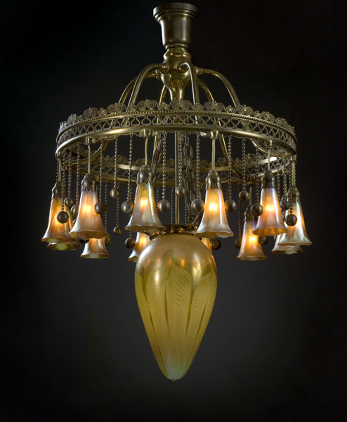 This a very rare Tiffany Moorish Chandelier with pulled feather and lily lights brought an astounding $59,800 (including the buyer's premium) at auction.