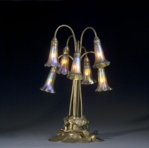 This Tiffany Seven-Light Lily Lamp with Gold Dore Base is one of the most innovative styles of the Tiffany lamps.  Originally selling for $80 100 years ago, it sold for $21,850 (including the buyer's premium) in October 2006.