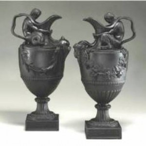 A pair of 19th-century Wedgwood wine & water ewers pieces in black basalt. Today, they are most likely found at auction and sell in the $5,000-$6.500 range.