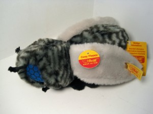 Steiff's 20-cm soft plush Flappy Fly from 1994, only the only year it was made. Note his bizarre eyes made of cobalt blue fabric printed with black hexagons.
