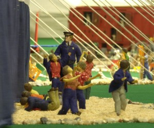 Kids sneaking under the canvas sidewall was such a popular illustration, that Howard Tibbals immortalized the image in his gigantic model of Ringling Bros. and Barnum & Bailey.