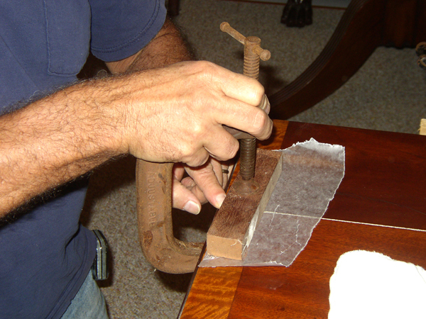 Wax paper under a glue block keep sit from sticking to the work.