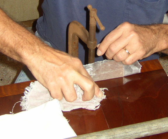 Clean up wet wood glue and even light coats of dry glue with a wet rag.