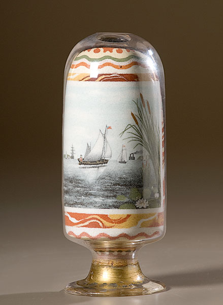 "The reverse depicts a maritime scene with cattails and lily pads in the foreground and sailing ships in the background; 7.25"" high. It sold for $15,275 in June of 2009."