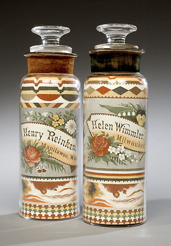 A pair of sweetheart sandbottles made by Andrew Clemens for Henry Reinken and his future wife, Helen Wimmler. They remained in the couple's family until passed to the current owner's family.
