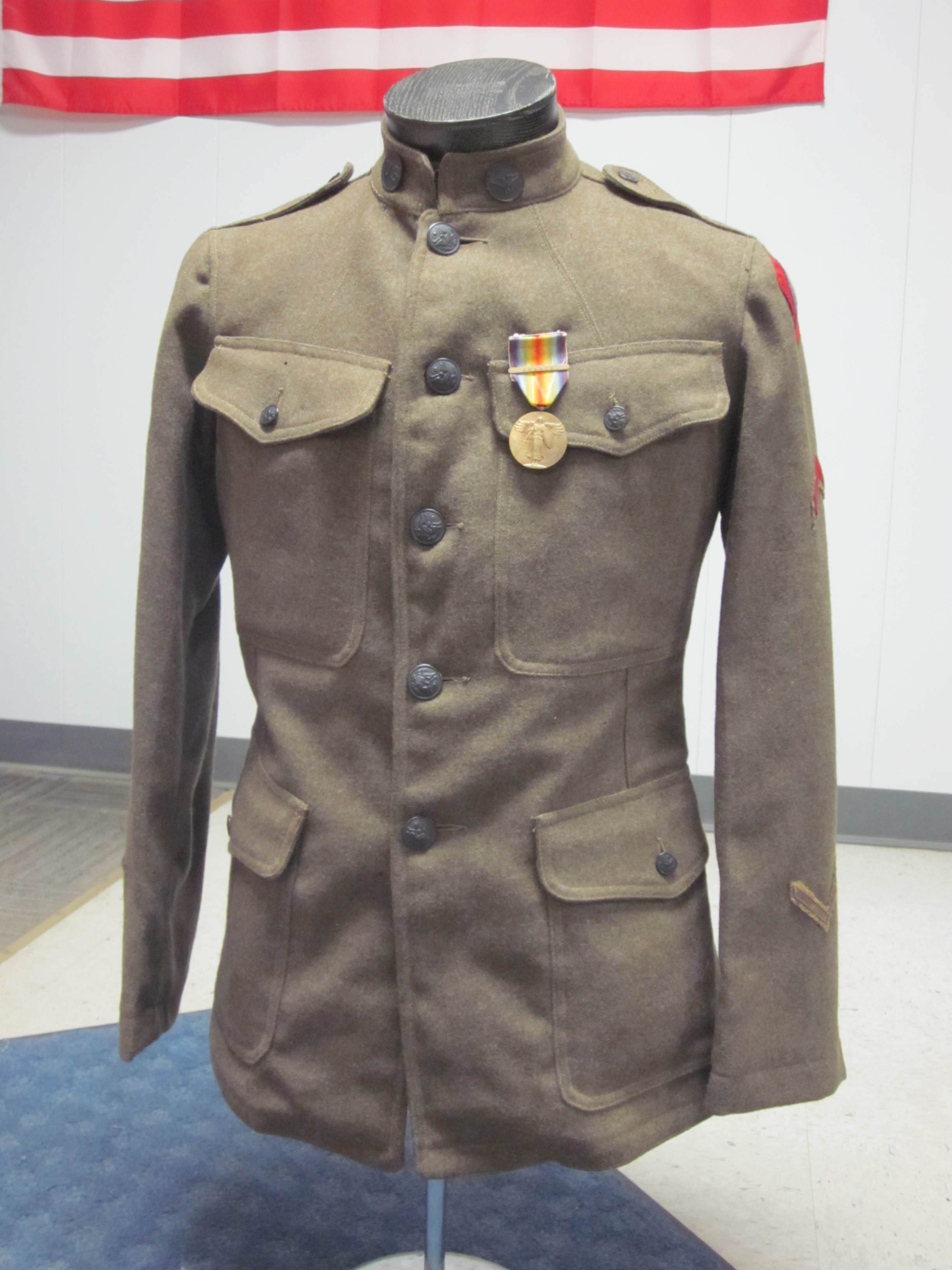 This WWI Model 1912 wool tunic comes with all period insignia ...