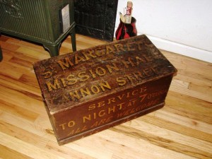 A box containing a portable reed organ used for worship services.