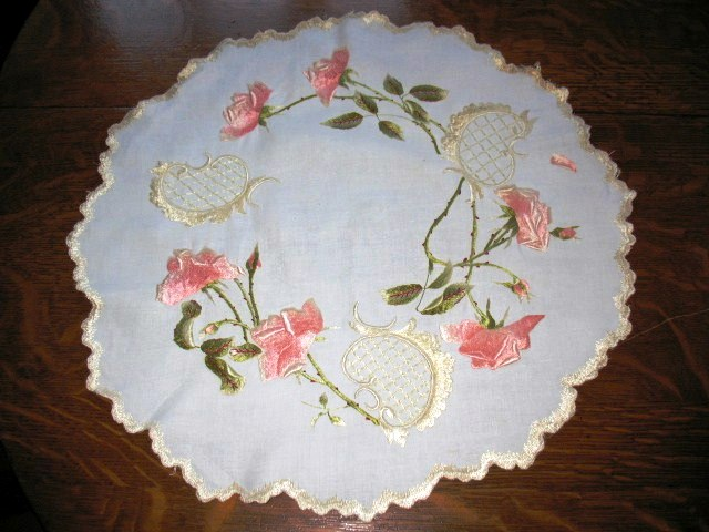 A very nice silk embroidery round measuring 20 inches across in a rose pattern.