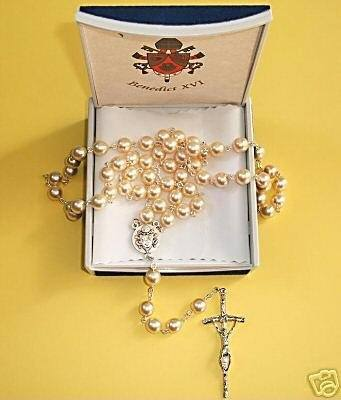 Among the most common papal memorabilia collected are the rosary and the scapular (right). Rosaries can be made of everything, from plastic to precious metal.