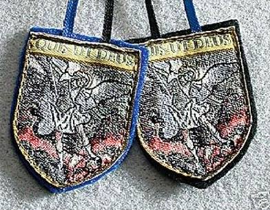 Scapulars—two pieces of cloth religious images held together with a string and placed around the shoulders—can be silk-screened or hand-embroider. These items are often received as gifts and have more sentimental or spiritual value than the $10 to $40 received at auction, especially ones received and blessed by the pope directly from the Vatican