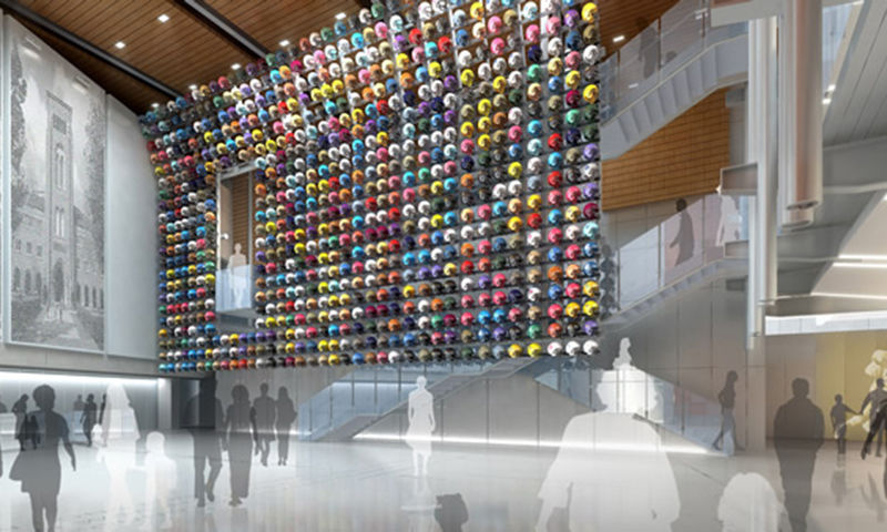 Visitors to the Hall of Fame will enter the Quad, where a massive wall of football helmet—representing every college football program in the country—is the center of attention.