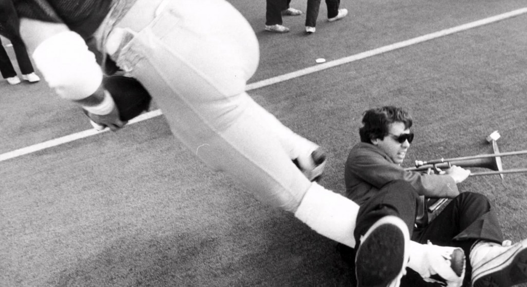 "Cal's Gary Moen knocks over Stanford Band trombone player Gary Tyrrell at the end of the ""The Play"" to win the 1982 Big Game. Tyrrell's trombone and case are enshrined in the College Football Hall of Fame."