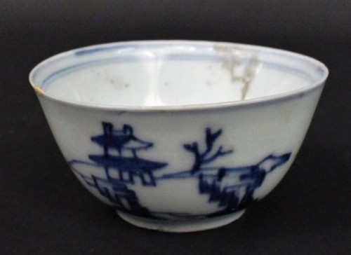 Chinese blue and white kangxi porcelain finger bowl with blue banding on interior, exterior with landscape with buildings and rocks, was purportedly recovered from the Vung Tau, a ship that sank off the coast of Vietnam in the late 17th century. Despite its history, it has a modest auction estimate, as it is expected to fetch between $100 and $200.