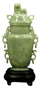 This 19th-century Chinese lavender jade covered vase, standing 10 ½ inches tall on a 2-inch base, should fetch between $2,000 and $3,000.