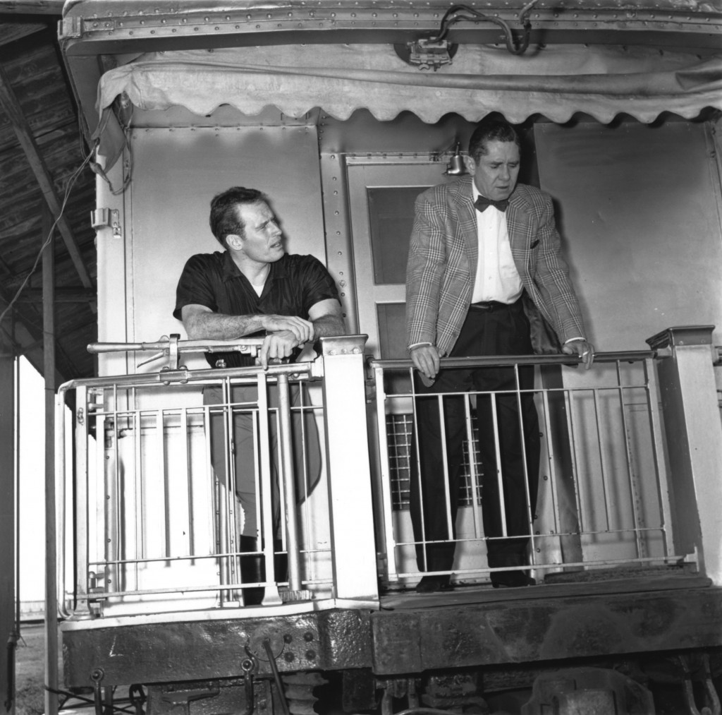 "John Ringling North (left) and Charlton Heston stand on the vestibule of Jomar. Heston starred as Brad, the tough circus manager in ""The Greatest Show on Earth"" motion picture. (Photo: RMA-Tibbals)"