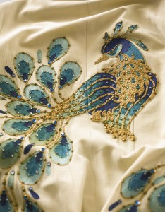 A peacock jumpsuit worn in concert by Elvis Presley realized $245,000.