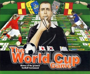 "Shaun Derrick's The World Cup Game, published in 2006 by Games for the World. The giant referee and penalty flags on the cover symbolize how much bad officiating has influenced the ""history of the greatest football tournament."""
