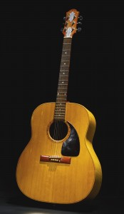 A 1977 Zemaitis acoustic guitar owned by the Rolling Stones' Ronnie wood realized $75,000.