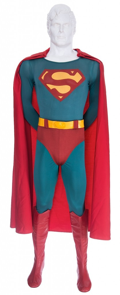 The Superman costume is a blue bodysuit with his trademark yellow belt. It is completed with a replicated of cape and boots.