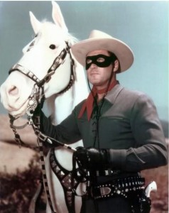 Clayton Moore as the Lone Ranger, with his horse Silver, from the television series.