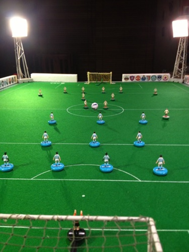 A modern Subbuteo pitch with electric lights. Fancy!