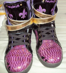 Someone paid $4 for these extremely ugly HeyDay Saints sneakers and sold them for $68 oh eBay.
