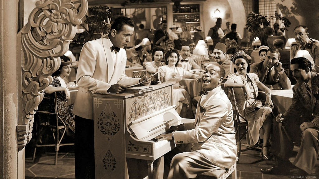 """Humphrey Bogart's Rick Blaine stands by as Sam plays the piano in Rick's Café American in the Hollywood classic """"Casablanca."""" That piano, one of the most famous in movie history, will be up for auction this November at Bonhams in the """"No Place like Hollywood"""" auction."""