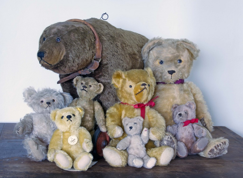 "A large grizzly bear on wheels appears to be protectively watching over a group of more traditional stuffed bears, all of which will be auctioned on Sept. 19 by the Norman C. Heckler & Company. The bears, some 1,100 in all, come from the one-woman collection of Charlotte ""Chotsie"" Lefevre, so amassed them over a 50-year span."