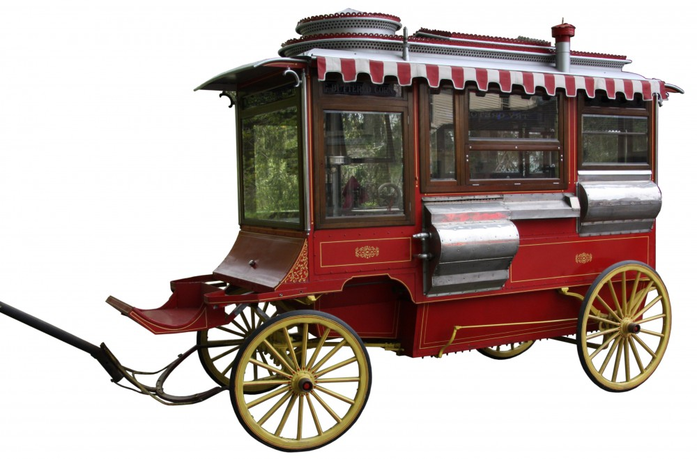 This Cretors & Company (Chicago) Model D popcorn wagon with driver's seat, measuring 12 feet, 8 inches long, is expected to realize between $10,000 to $15,000.