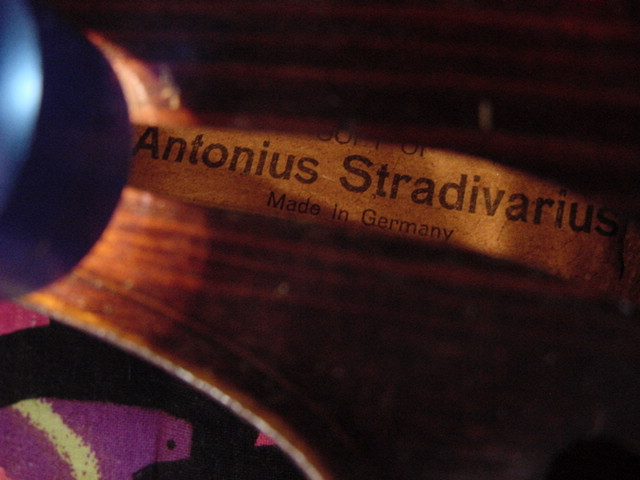 "A label that clearly states ""Made in Germany"" and that the violin is a copy of a Stradivarius. Even without a date, this label tells us that the violin was manufactured after 1921, because it's labeled according the requirements of the McKinley Act."