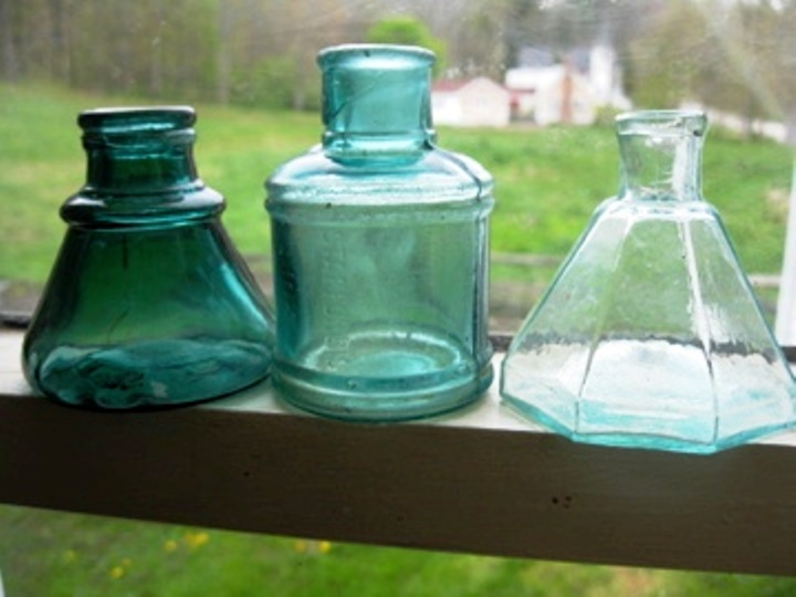 Three bottles that were found while digging (left to right): an unembossed pontiled, 12-sided ink bottle in medium green, attributed to the Keene, N.H., Glass Works, circa 1840 (value $150); an aqua, pontiled, eight-sided Harrison's Columbian Ink bottle (value $150); and a rare sapphire blue eight-sided, pontiled Harrison's Columbian Ink bottle with lip repair (value $1,000 as is).