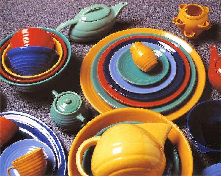 """This assortment is predominantly Ring ware. Ring, designed by Danish potter Louis Ipsen, was Bauer's best seller. It was augmented by others over the years including Ray Murray. The photo was cover art for the Collector Books publication """"The Collector's Encyclopedia of Bauer Pottery"""" by the author."""