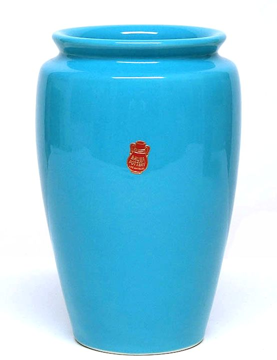 The hand-thrown art pottery of Fred Johnson was more refined than the work of his uncle, Matt Carlton. This turquoise-glazed vase retains a Bauer paper label. These labels are rarely seen and add value to any item.