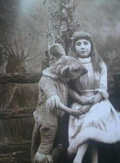 A girl with a rather large rodent. Could it be the mythical R.O,U.S.?