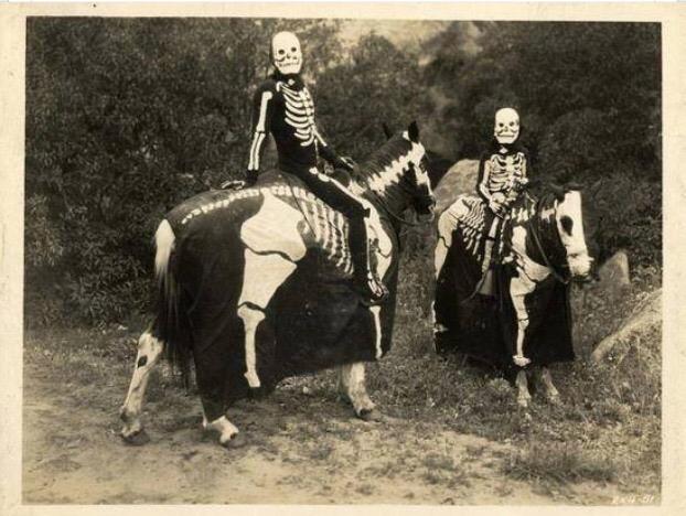 Death nd his little sister on skeletal horseback.